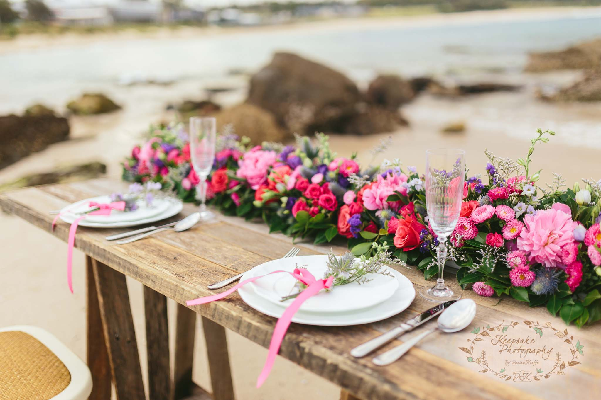 beach wedding inspiration sea ocean nautical rustic vintage wooden flowers pink reed purple sail and swan