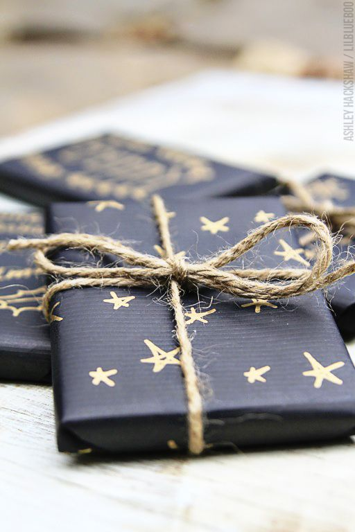Gift Wrapping Ideas for Christmas gold stars pen sail and swan